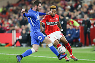 Peterborough United defender Jason Naismith (2) tackles Middlesbrough forward Britt Assombalonga (9) during The FA Cup 3rd round match between Middlesbrough and Peterborough United at the Riverside Stadium, Middlesbrough, England on 5 January 2019.