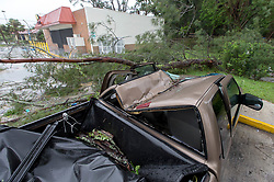 September 10, 2017 - Wellington, Florida, U.S. - A tree landed on the cab of a truck parked near Lake Worth Road and Jog road during Hurricane Irma. (Credit Image: © Allen Eyestone/The Palm Beach Post via ZUMA Wire)