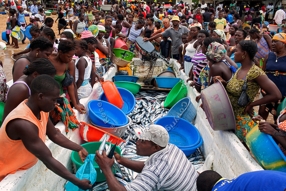 Fishermen are selling the fish caught in the morning, in Praia Cruz, on the island of Sao Tome, Sao Tome and Principe, (STP) a former Portuguese colony in the Gulf of Guinea, West Africa.