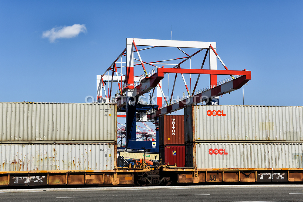 Containers on Flat Bed Train Cars with Cargo Crane, in the Port of Long Beach