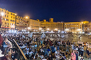 Italy, Siena, the Palio: and the celebrations and parties goes on in the nigth throw the streets of the city and in the Piazza del Campo , with singing and drumming from the winners.