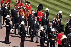 The Prince of Wales, the Duke of York, the Duke of Cambridge, Peter Phillips, the Princess Royal, the Earl of Wessex, the Duke of Sussex, the Earl of Snowdon and Vice-Admiral Sir Timothy Laurence follow the Duke of Edinburgh's coffin, covered with his Personal Standard, on the purpose built Land Rover Defender outside St George's Chapel, Windsor Castle, Berkshire, ahead of the funeral of the Duke of Edinburgh. Picture date: Saturday April 17, 2021.