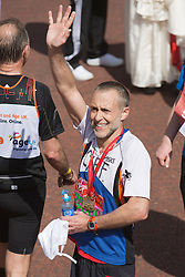© Licensed to London News Pictures. 21/04/2013. London, England. Picture: Celebrity Chef Michel Roux Jr. Celebrity Runners and Fun Runners finish the Virgin London Marathon 2013 race in the Mall, London. Many wore black ribbons to pay their respect for those who died or were injured in the Boston Marathon. Photo credit: Bettina Strenske/LNP