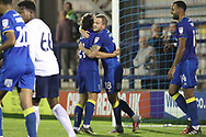 AFC Wimbledon midfielder Dean Parrett (18) celebrating after scoring goal to make it 4-3 during the EFL Trophy match between AFC Wimbledon and Tottenham Hotspur at the Cherry Red Records Stadium, Kingston, England on 3 October 2017. Photo by Matthew Redman.