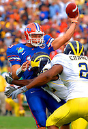 University of Florida quarterback Tim Tebow is pressured by the University of Michigan defense.