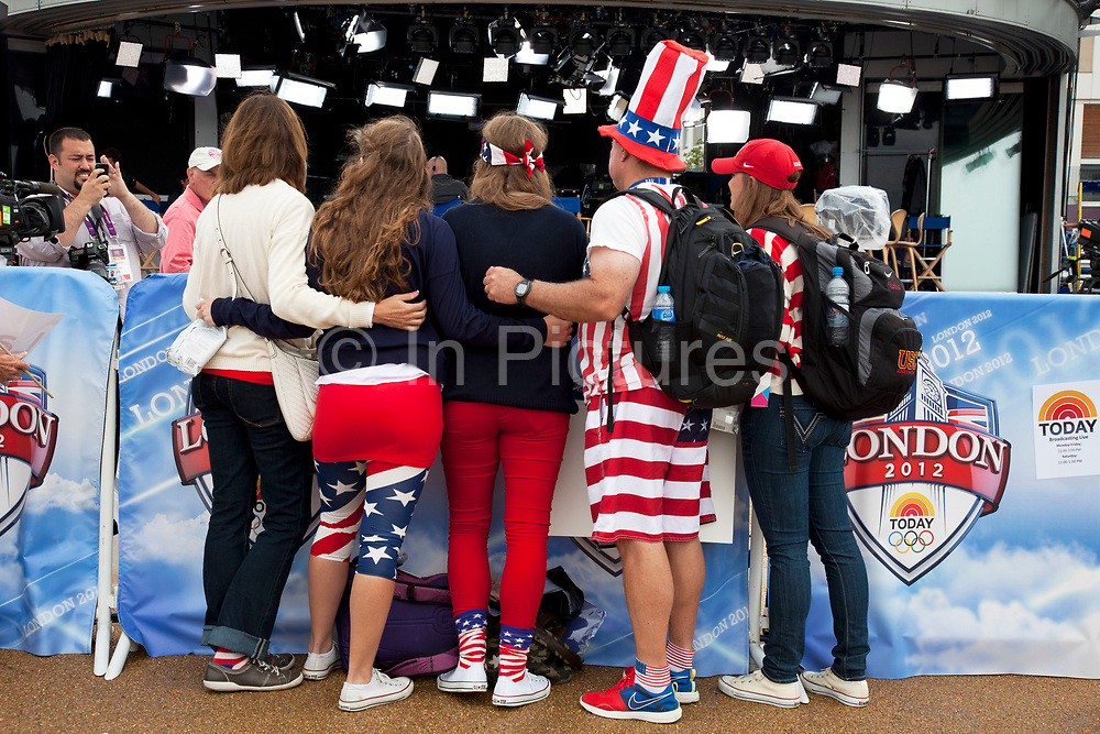 London 2012 Olympic Park in Stratford, East London. Fans of Team USA are abundant at the park. Wearing stars and stripes, the flag of America is a common sight.