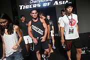 """Adrian Pang, Legend Lightweight Champion, in centre during rehearsals<br /><br />MMA. Mixed Martial Arts """"Tigers of Asia"""" cage fighting competition. Top professional male and female fighters from across Asia, Russia, Australia, Malaysia, Japan and the Philippines come together to fight. This tournament takes place in front of a ten thousand strong crowd of supporters in Pelaing Stadium. Kuala Lumpur, Malaysia. October 2015"""