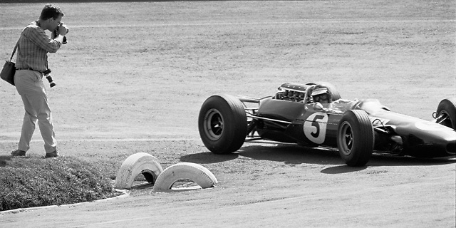 """""""Me 'n Jimmy"""" — Pete Lyons shoots Jim Clark rounding the hairpin at the Mexico City circuit during the 1965 Mexican Grand Prix; photo by Ozzie Lyons"""