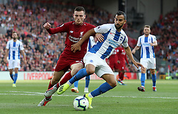 Liverpool's Andrew Robertson (left) and Brighton & Hove Albion's Leon Balogun during the Premier League match at Anfield, Liverpool.