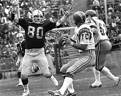 Oakland Raiders Art Thoms #80 after San Diego Charger quarterback Bobby Douglas..(1975 photo/Ron Riesterer)