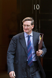 "© Licensed to London News Pictures. 29/08/2013. London, UK. Attorney General Dominic Grieve leaves a meeting of the British cabinet on Downing Street in London today (29/08/2013) as a recalled British Parliament prepares to debate the possibility of ""direct"" military action over recent reports an alleged chemical weapons attack in Syria. Photo credit: Matt Cetti-Roberts/LNP"