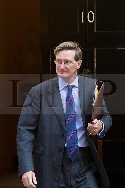 """© Licensed to London News Pictures. 29/08/2013. London, UK. Attorney General Dominic Grieve leaves a meeting of the British cabinet on Downing Street in London today (29/08/2013) as a recalled British Parliament prepares to debate the possibility of """"direct"""" military action over recent reports an alleged chemical weapons attack in Syria. Photo credit: Matt Cetti-Roberts/LNP"""