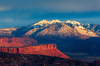 Looking across Arches National Park over Castle Valley, with the LaSal mountains covered in snow in the background.