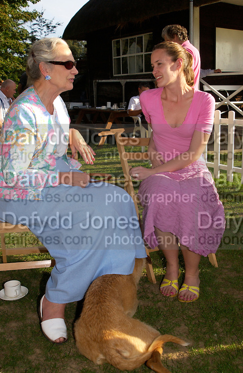 The Duchess of Richmond and Corinna Csaky, The Duke of Richmond and Gordon's X1 V The Earl of March and Kinrara's X1. Cricket match before the Goodwood Revival meeting, 2 September 2004. SUPPLIED FOR ONE-TIME USE ONLY-DO NOT ARCHIVE. © Copyright Photograph by Dafydd Jones 66 Stockwell Park Rd. London SW9 0DA Tel 020 7733 0108 www.dafjones.com