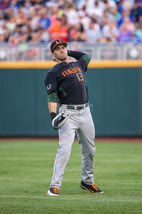 Willie Abreu (13) of the Miami Hurricanes throws during a game between the Miami Hurricanes and Florida Gators at TD Ameritrade Park on June 13, 2015 in Omaha, Nebraska. (Brace Hemmelgarn)
