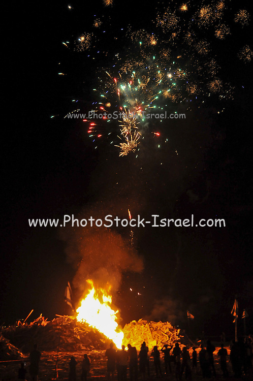 Celebrating the Jewish holiday of Lag Baomer with a bonfire and fireworks