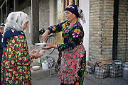 Bukhara, Uzbekistan, 18/05/2004..Street traders in the centre of the old town in the early morning.