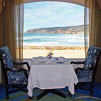 Europe, Portugal, Cascais; A romantic table at Fortaleza do Guincho, a Relais & Chateaux restaurant and hotel on the Estoril coast of Cascais.