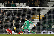 Tom Bradshaw of Barnsley (L) scores his team's first goal. EFL Skybet championship match, Fulham v Barnsley at Craven Cottage in London on Saturday 23rd December 2017<br /> pic by Steffan Bowen, Andrew Orchard sports photography.