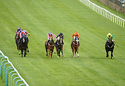David Probert riding Pitchcombe (left, red and white cap) on their way to winning the Download The vickers.bet App Handicap at Brighton racecourse. Picture date: Tuesday October 5, 2021.