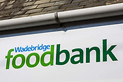 Wadebridge foodbank sign outside the Trussell Trust foodbank and storehouse in Bridgend, Cornwall, United Kingdom.  This foodbank provides emergency food parcels for individuals and families in crisis in Bodmin, Camelford, Padstow and Wadebridge.