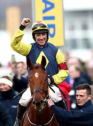 Jockey Davy Russell celebrates winning the Brown Advisory & Merriebelle Stable Plate with horse The Storyteller during St Patrick's Thursday of the 2018 Cheltenham Festival at Cheltenham Racecourse.