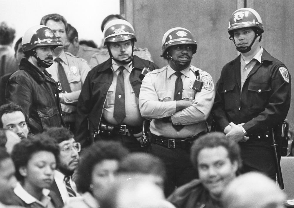 ©1990 police at city council hearing where KKK applied for a parade permit.