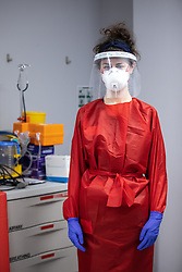 """© Licensed to London News Pictures . 21/05/2020 . Manchester , UK . Staff Nurse ANYA MATTOCKS wearing PPE outside one of the hospital's """" Hot Zones """" , ahead of entering a room to treat a patient suspected of having Covid-19 . Specialist cancer centre , The Christie Hospital , is adapting in order to ensure the safety of patients and staff . They are reporting a drop in referrals during the UK's Coronavirus lockdown and there is concern that cancers are going undiagnosed and untreated . Photo credit : Joel Goodman/LNP"""