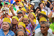 04 AUGUST 2013 - BANGKOK, THAILAND: People shout anti-Thaksin slogans during a rally against former Prime Minister Thaksin Shinawatra and the current Prime Minister, Yingluck Shinawatra, his sister. About 2,000 people, members of the  People's Army against Thaksin Regime, a new anti-government group, protested in Lumpini Park in central Bangkok. The protest was peaceful but more militant protests are expected later in the week when the Parliament is expected to debate an amnesty bill which could allow Thaksin Shinawatra, the exiled former Prime Minister, to return to Thailand.     PHOTO BY JACK KURTZ