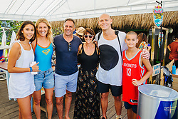 BALI, INDONESIA - MAY 19: Two-time Gold Medalist Michael Klim of Australia (white shirt) with daughter (left) and son (right) with seven-time WSL Champion Stephanie Gilmore of Australia (blue shirt) at the 2019 Corona Bali Protected at Keramas on May 19, 2019 in Bali, Indonesia. (Photo by Matt Dumbar/WSL via Getty Images)
