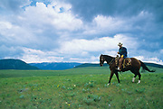 """LIVINGSTON, MT - AUGUST:  Robert Redford rides his horse through a field during the filming of """"The Horse Whisperer"""" in 1997. (Photo by John Kelly/Getty Images)"""