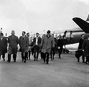 Irish Rugby Football Union, Ireland v Scotland, Five Nations, Scottish team arrives at Dublin Airport, Dublin, Ireland, Thursday 22nd February, 1962,.22.2.1962, 2.22.1962,..Scottish Team, ..K J F Scotland, Wearing number 15 Scottish jersey,  Full Back, Leicester Rugby Football Club, Leicester, England, ..R C Cowan, Wearing number 11 Scottish jersey,  Left Wing, Selkirk Rugby Football Club, Selkirk, Scotland, ..I H P Laughland, Wearing number 12 Scottish jersey, Left Centre, London Scottish Rugby Football Club, Surrey, England, ..J J McPartlin, Wearing number 13 Scottish jersey,  Right Centre, Oxford University Rugby Football Club, Oxford, England,..A R Smith, Wearing number 14 Scottish jersey, Captain of the Irish team,  Right Wing, Edinburgh University Rugby Football Club, Edinburgh, Scotland, ..G H Waddell, Wearing number 10 Scottish jersey,  Stand Off, London Scottish Rugby Football Club, Surrey, England, ..S Coughtrie, Wearing number 9 Scottish jersey,  Scrum Half, Edinburgh Academical Rugby Football Club, Edinburgh, Scotland, ..H F McLeod, Wearing number 1 Scottish jersey,  Forward,  Hawick Rugby Football Club, Hawick, Scotland, ..N S Bruce, Wearing number 2 Scottish jersey,  Forward, London Scottish Rugby Football Club, Surrey, England, ..R Steven , Wearing number 3 Scottish jersey, Forward, Edinburgh Wanderers Rugby Football Club, Edinburgh, Scotland, ..F H ten Bos, Wearing number 4 Scottish jersey,  Forward, London Scottish Rugby Football Club, Surrey, England, ..M J Campbell-Lamberton, Wearing number 5 Scottish jersey, Forward, Halifax Rugby Football Club, Yorkshire, England, ..R J C Glasgow, Wearing number 6 Scottish jersey,  Forward, Dunfermline Rugby Football Club, Fife, Scotland, ..J Douglas, Wearing number 8 Scottish jersey, Forward, Stewarts College Rugby Football Club, Edinburgh, Scotland, ..K I Ross, Wearing number 7 Scottish jersey, Forward, Boroughmuir Rugby Football Club, Edinburgh, Scotland, .