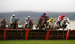 Santini and Jeremiah McGrath (centre left, grey cap) trail the leaders over an early flight before going on to win The ballymore Classic Novices' Hurdle Race run during Festival Trials Day at Cheltenham Racecourse.