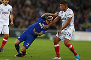 Lee Tomlin of Cardiff city (l) is fouled by Gareth Evans of Portsmouth. Carabao Cup, 1st round match, Cardiff city v Portsmouth at the Cardiff city Stadium in Cardiff, South Wales on Tuesday August 8th 2017.<br /> pic by Andrew Orchard, Andrew Orchard sports photography.