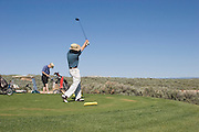 Two golfers tee off at Taos Country Club