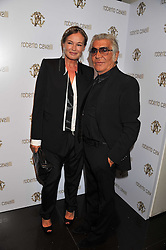 ROBERTO & EVA CAVALLI  at a party hosted by Roberto Cavalli to celebrate his new Boutique's opening at 22 Sloane Street, London followed by a party at Battersea Power Station, London SW8 on 17th September 2011.