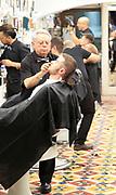 Traditional barber shop customer being shaved, El Kinze de Cuchilleros, Madrid city centre, Spain