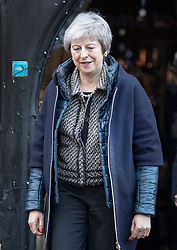 © Licensed to London News Pictures. 07/12/2018. Maidenhead, UK. Prime Minister Theresa May walks under Christmas decorations as she visits a church in her Maidenhead constituency. Cabinet ministers are touring the UK today to try and sell Mrs May's Brexit deal ahead of the meaningful vote in Parliament on Tuesday.  Photo credit: Peter Macdiarmid/LNP