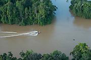 Boat on river<br /> Essequibo River<br /> GUYANA<br /> South America<br /> Longest river in Guyana