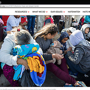 Asylum seekers who had traveled from Central America wait despairingly in line at the San Ysidro Port of Entry in Tijuana. The migrants were looking at months before their number would be called. Photographed for Southern Poverty Law Center.