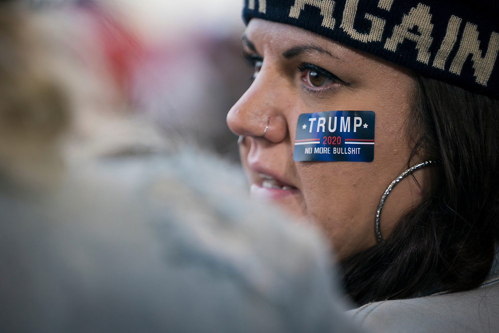Supporters talk before a 'Make America Great Again' rally in Duluth, Minnesota, U.S. on Wednesday, Sept. 30, 2020. Trump and Democratic nominee Joe Biden began their first debate on an acrimonious note and quickly made it personal, with each candidate interrupting and talking over each other. Photographer: Ben Brewer/Bloomberg