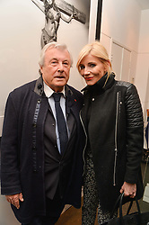 TERRY O'NEILL and MICHELLE COLLINS at a private view of photographs 'Terry O'Neill-The Best Of' held at The Little Black Gallery, 13A Park Walk, London on 16th January 2014.