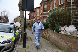 © Licensed to London News Pictures. 25/01/2020. London, UK. A forensic officer on Mount Pleasant Road in Clapton, East London. Police launch a murder investigation at a residential property following fatal stabbing after 11pm on Friday 24 January following reports of a disturbance. A man was found with stab injuries inside the property and died later. A 27 year old man was arrested at the scene on suspicion of murder. Photo credit: Dinendra Haria/LNP
