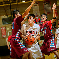 010915  Adron Gardner/Independent<br /> <br /> Gallup Bengal Colton Lowley (32) looks for a move around Shiprock Chieftains Andre Joe (11), left, and Artemio Curley (24) during the Gallup Invitational Basketball Tournament at Gallup High School Friday.