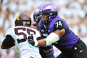 FORT WORTH, TX - SEPTEMBER 13:  Halapoulivaati Vaitai #74 of the TCU Horned Frogs blocks Theiren Cockran #55 of the Minnesota Golden Gophers on September 13, 2014 at Amon G. Carter Stadium in Fort Worth, Texas.  (Photo by Cooper Neill/Getty Images) *** Local Caption *** Halapoulivaati Vaitai