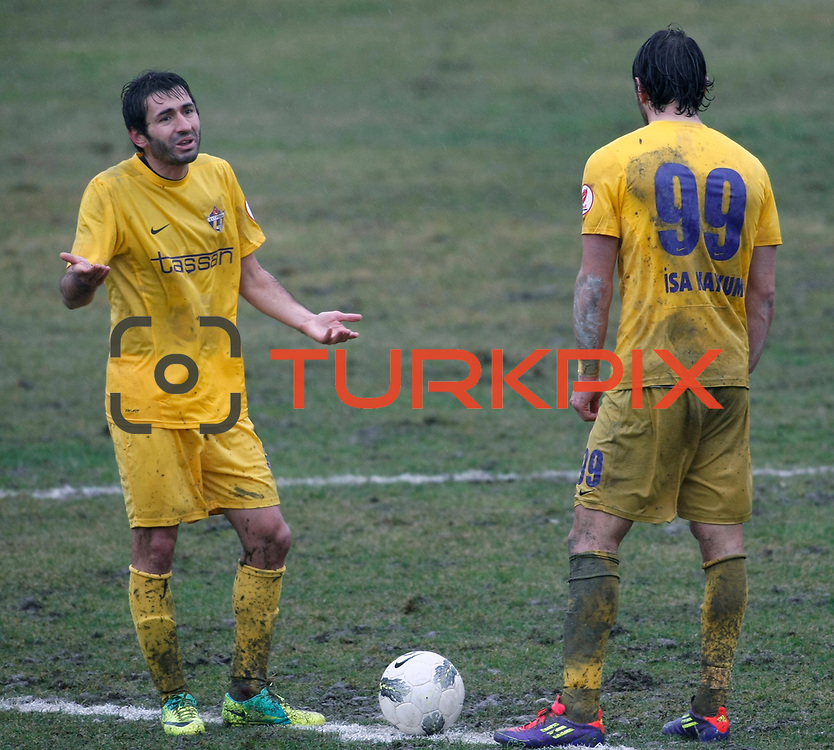 Eyupspor's Savas Esen (L) during their Turkey Cup matchday 3 soccer match Eyupspor between Eskisehirspor at Eyup Stadium in Istanbul Turkey on Wednesday, 11 January 2012. Photo by TURKPIX