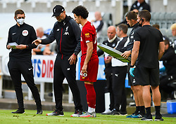 LIVERPOOL, ENGLAND - Sunday, July 26, 2020: Liverpool's manager Jürgen Klopp prepares to bring on substitute Curtis Jones during the final match of the FA Premier League season between Newcastle United FC and Liverpool FC at St. James' Park. The game was played behind closed doors due to the UK government's social distancing laws during the Coronavirus COVID-19 Pandemic. Liverpool won 3-1 and finished the season as Champions on 99 points. (Pic by Propaganda)
