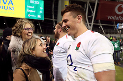 England's Henry Slade celebrates with his mum Jayne (back left) and girlfriend Megan after the Guinness Six Nations match at the Aviva Stadium, Dublin.
