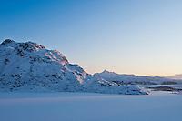 Snow covered Vikvatnet lake in winter, Vestvagoy, Lofoten Islands, Norway