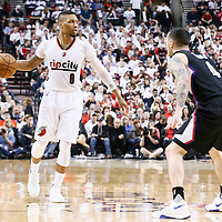 25 April 2016: Los Angeles Clippers guard J.J. Redick (4) defends on Portland Trail Blazers guard Damian Lillard (0) during the Portland Trail Blazers 98-84 victory over the Los Angeles Clippers, during Game Four of the Western Conference Quarterfinals of the NBA Playoffs at the Moda Center, Portland, Oregon, USA.